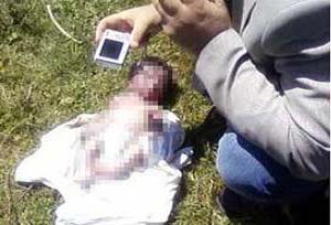 Bebeğini 'Öldü' zannedip çöpe attı.15056