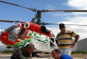 Helikopter enkazı barajdan çıkartılıyor.14081